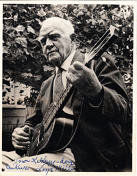 "old photo of ""Padre"" Loye Miller playing guitar, autographed"